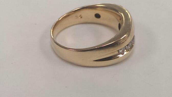 Gent's Gold-Diamond Wedding Band 7 Diamonds .70 Carat T.W. 14K Yellow Gold 7.8g