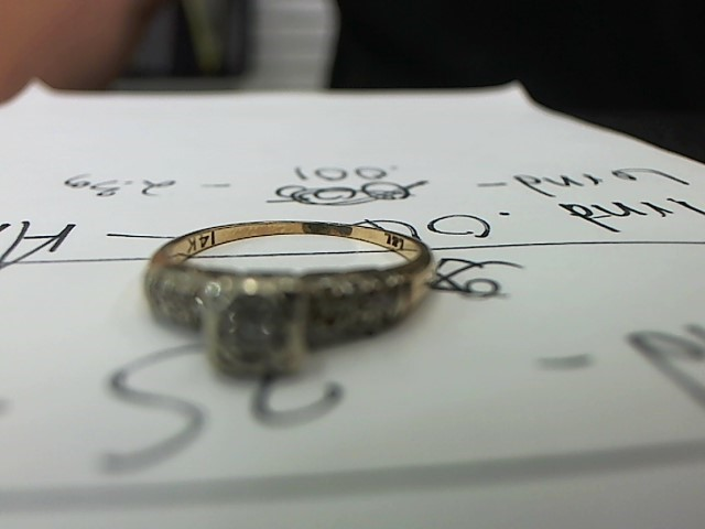 Lady's Diamond Fashion Ring .06 CT. 14K Yellow Gold 2.3g