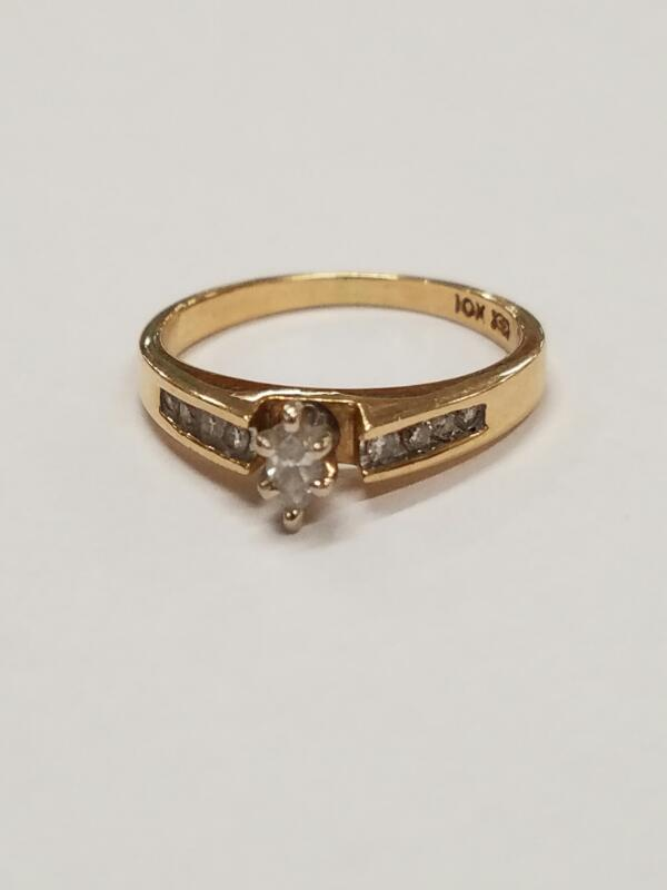 Lady's Diamond Solitaire Ring .01 CT. 10K Yellow Gold 2.1g