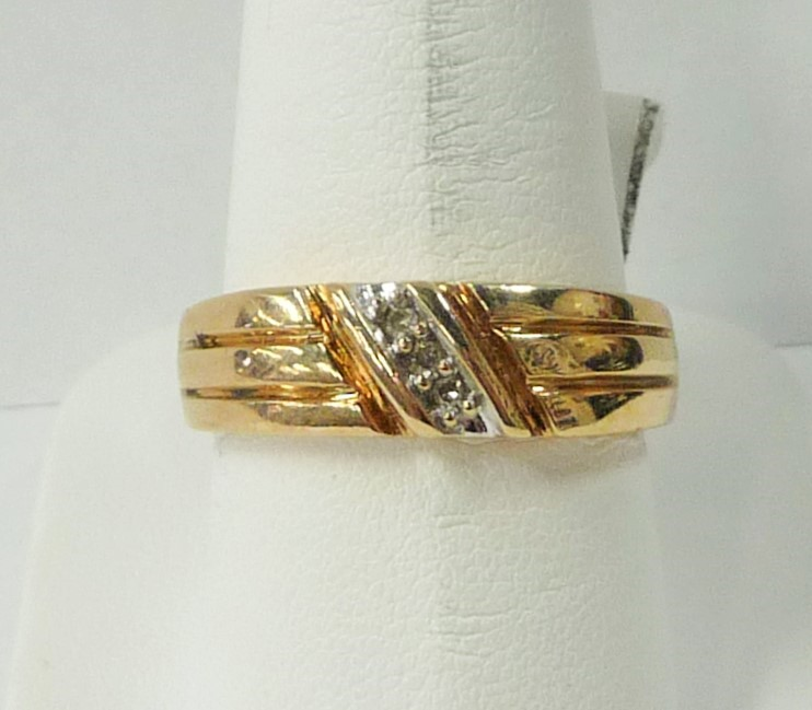 Gent's Gold-Diamond Wedding Band 3 Diamonds .09 Carat T.W. 10K Yellow Gold