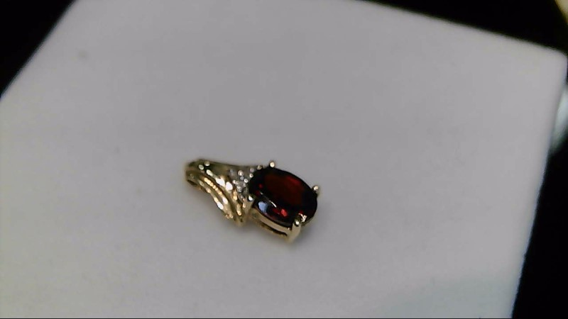 Lady's 10k yellow gold oval garnet with 1-1mm round diamond pendant