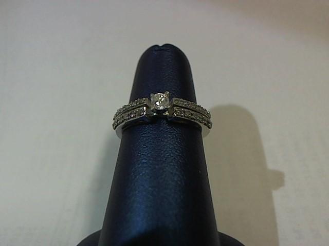 Lady's Diamond Fashion Ring 25 Diamonds .124 Carat T.W. 10K White Gold 2.1g