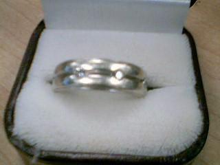 Gent's Gold-Diamond Wedding Band 3 Diamonds .15 Carat T.W. 10K White Gold 8.6g