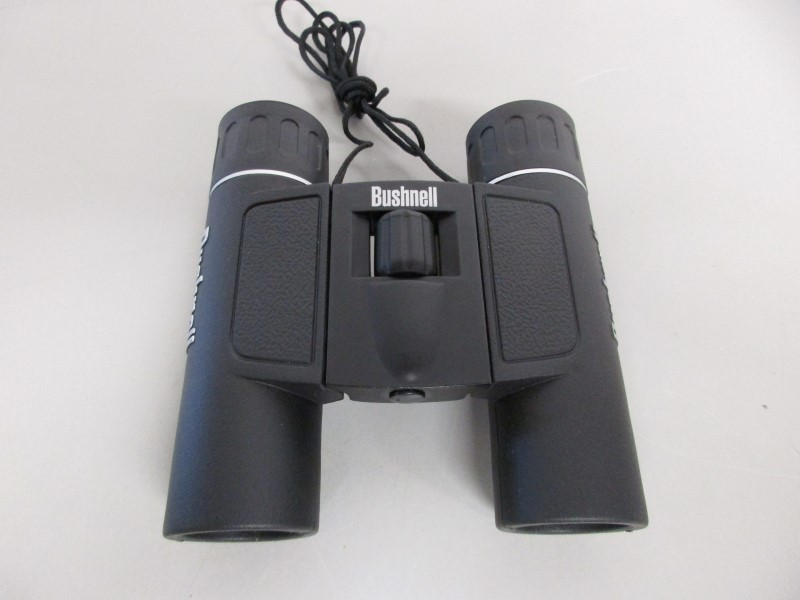 BUSHNELL 12X25 240FT at 1000 YDS BINOCULARS