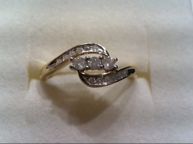 Lady's Diamond Fashion Ring 15 Diamonds .27 Carat T.W. 10K Yellow Gold 1.9g