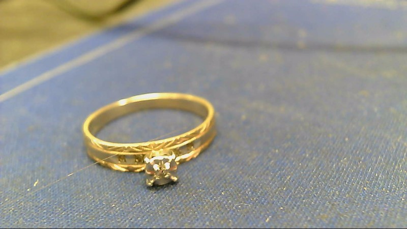 Lady's Diamond Engagement Ring .01 CT. 10K Yellow Gold 1.6g