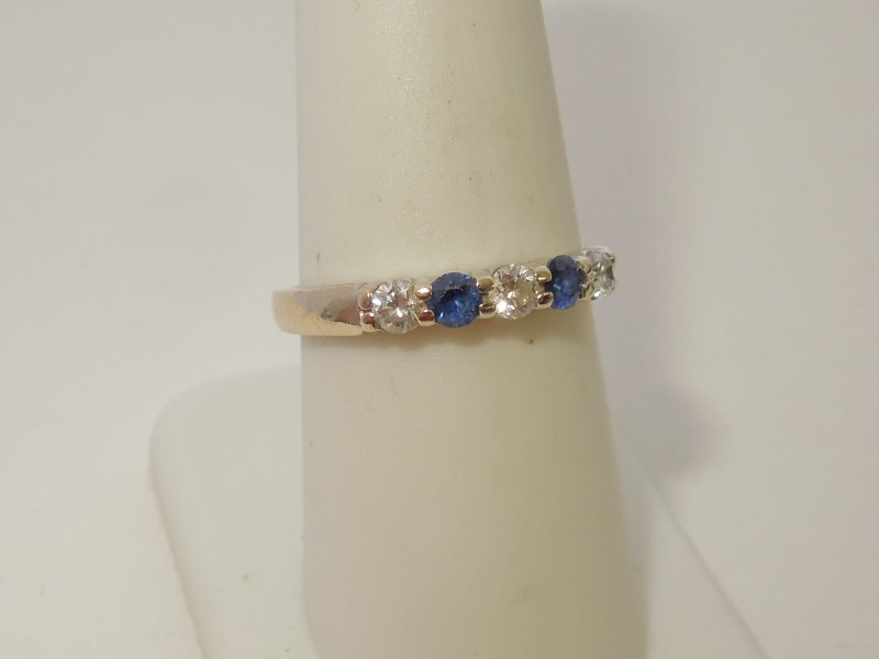 Synthetic Sapphire Lady's Stone & Diamond Ring 3 Diamonds .30 Carat T.W.