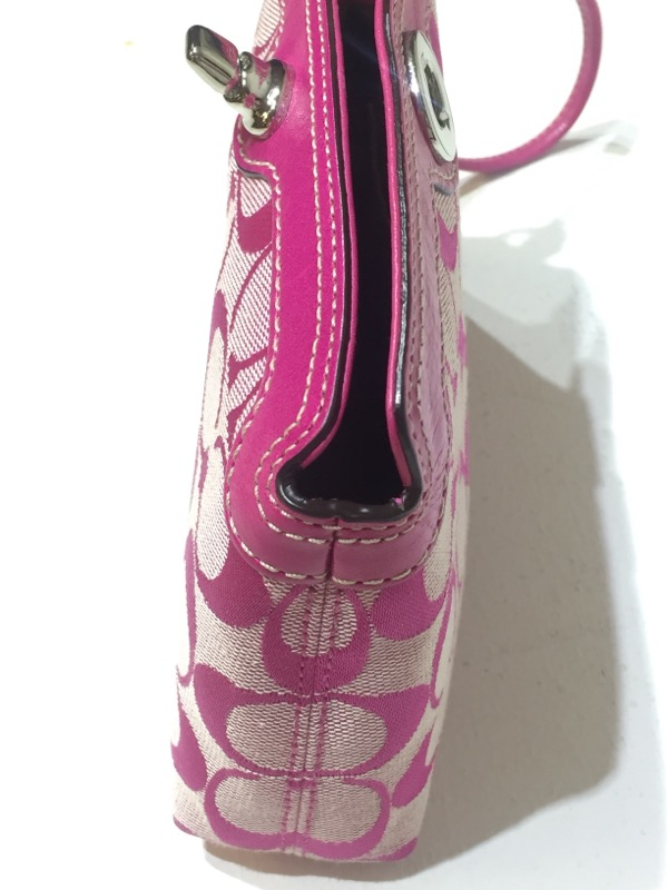 COACH CRICKET SIGNATURE CANVAS WRISTLET, IN PINK WITH MONOGRAM LOGO