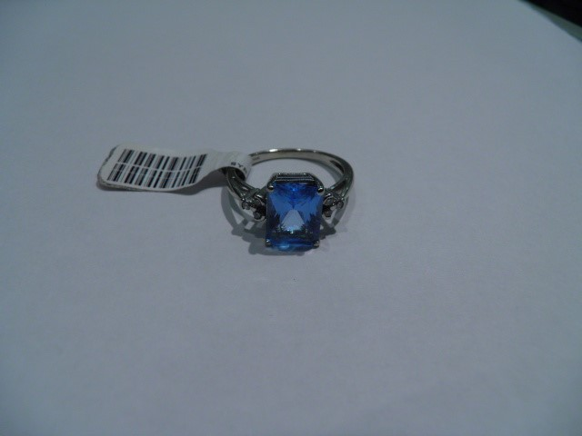 Synthetic Blue Topaz Lady's Stone & Diamond Ring 6 Diamonds .12 Carat T.W.