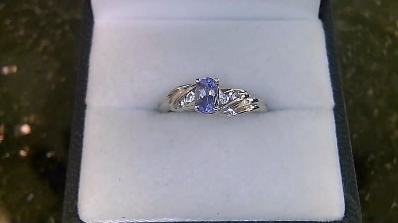 LADY'S 10K WHITE GOLD OVAL TANANITE WITH 4 ROUND CUBIC ZIRCONIA RING