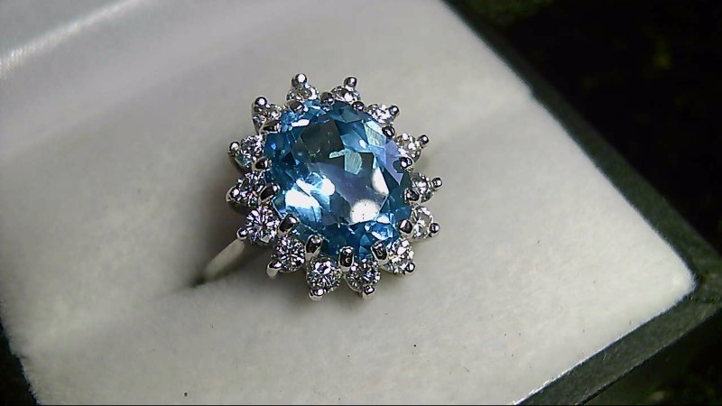 Oval Blue Topaz Lady's Stone & Multiple Diamond Ring