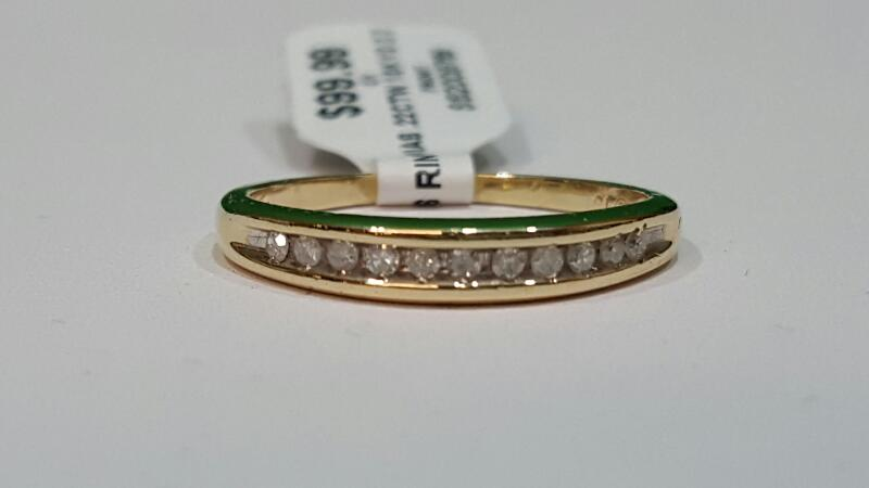 Lady's Diamond Wedding Band 11 Diamonds .22 Carat T.W. 10K Yellow Gold 2.3g