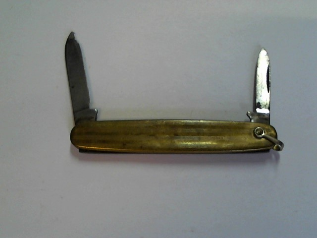 BRASS KNIFE LOOKS LIKE STAMP IS M5R OR MSR  USA  BLADE HAS CHIP TIP