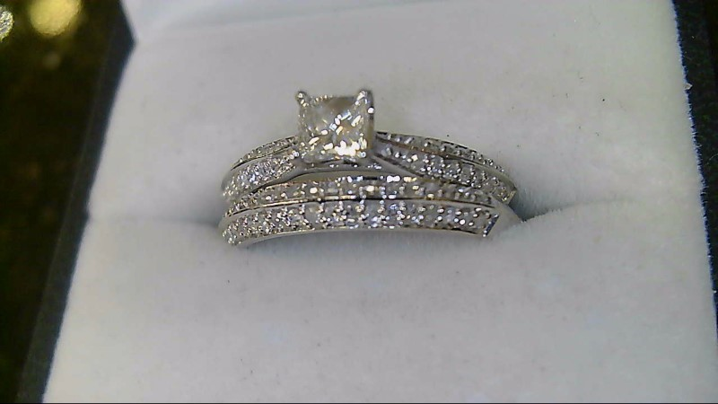 lady's 14k white gold .39ct princess cut with round dia accent wed set