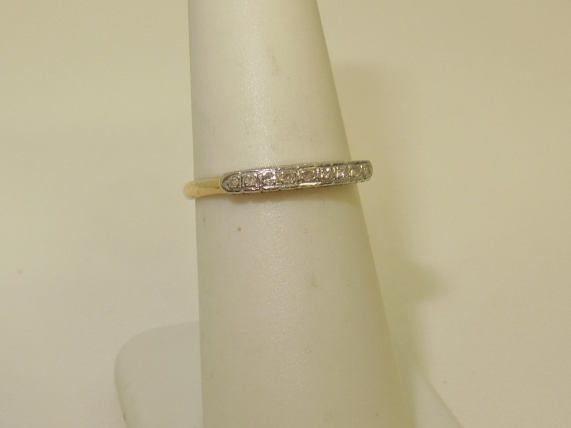 Lady's Diamond Wedding Band 9 Diamonds .045 Carat T.W. 14K 2 Tone Gold 1.1g