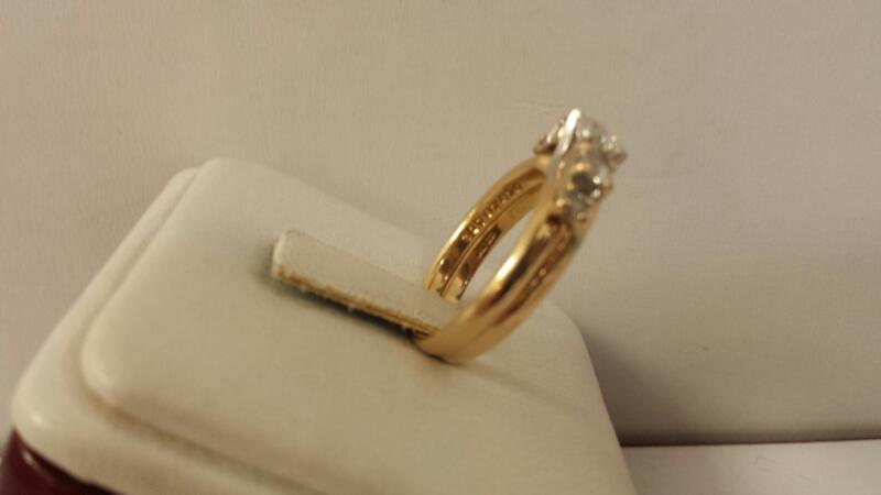 14k Yellow Gold Ring Set with 1 Heart Diamond at .39ctw and 4 Round Diamonds