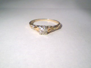 Lady's Diamond Solitaire Ring .13 CT. 14K 2 Tone Gold 1.4g