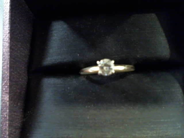 Lady's Diamond Solitaire Ring .25 CT. 14K Yellow Gold 1.2g Size:5.5