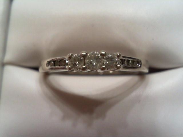 Lady's Silver-Diamond Ring 11 Diamonds .21 Carat T.W. 925 Silver 2.2g