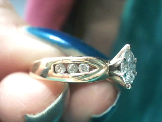 Lady's Diamond Solitaire Ring 7 Diamonds .32 Carat T.W. 14K Yellow Gold 1.8dwt