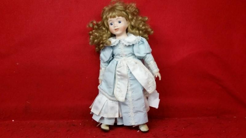 Seymour Mann Porcelain Doll with Curly Hair & Blue Dress