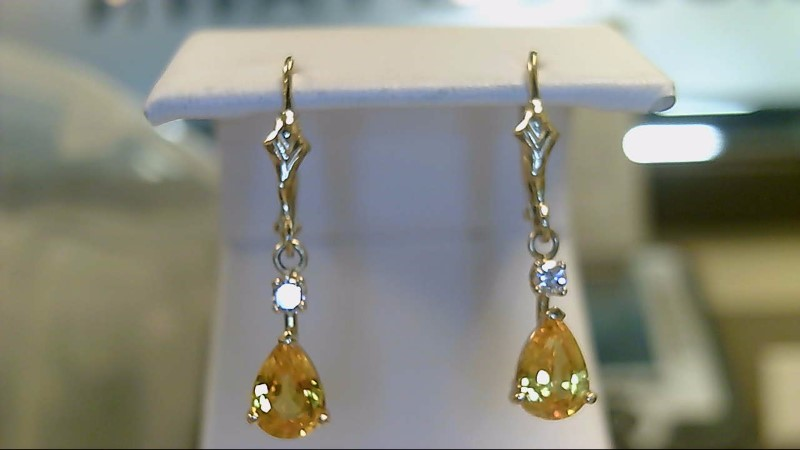 Lady's 14k yellow gold genuine pear yellow sapphire and round diamond earrings
