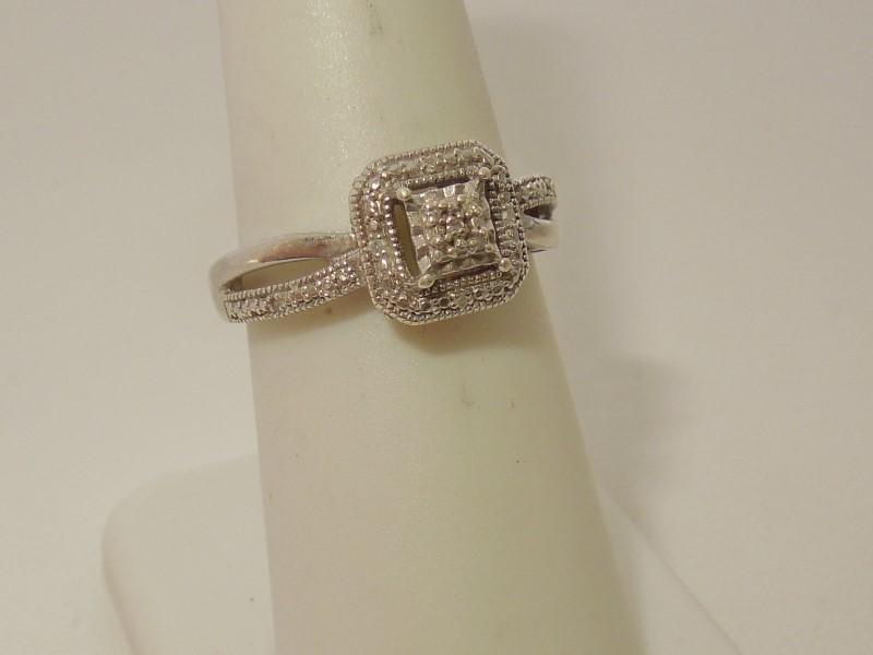Lady's Silver-Diamond Ring 11 Diamonds .055 Carat T.W. 925 Silver 2.8g