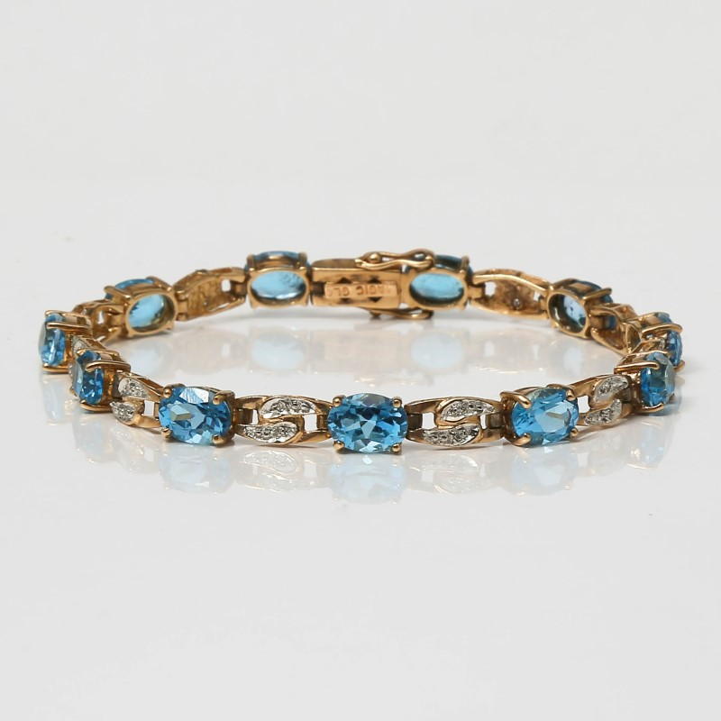 "6 3/4"" 10K Yellow Gold Oval Cut Blue Topaz Bracelet"