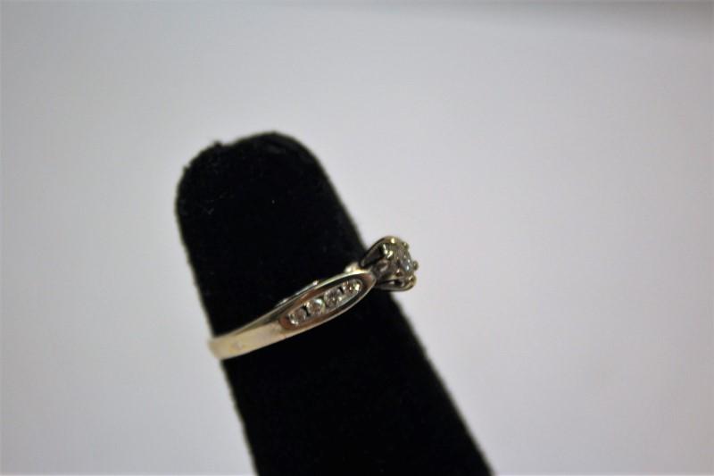 Lady's Diamond Engagement Ring 9 Diamonds .21 Carat T.W. 10K Yellow Gold 1.9g