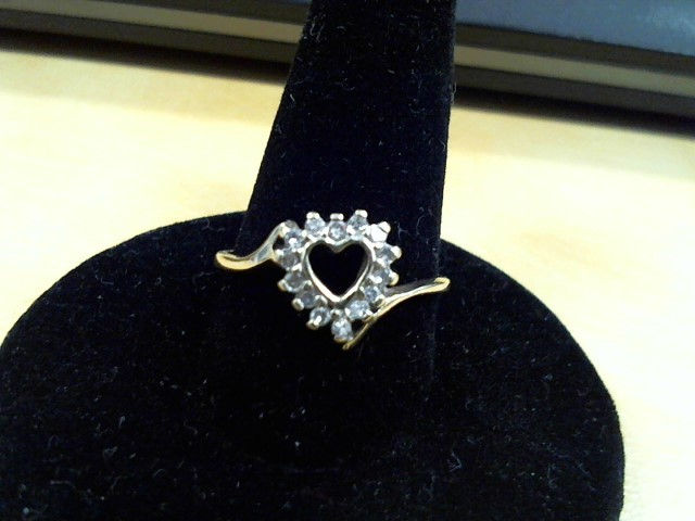 Lady's Diamond Fashion Ring 12 Diamonds .24 Carat T.W. 10K Yellow Gold 1.6g