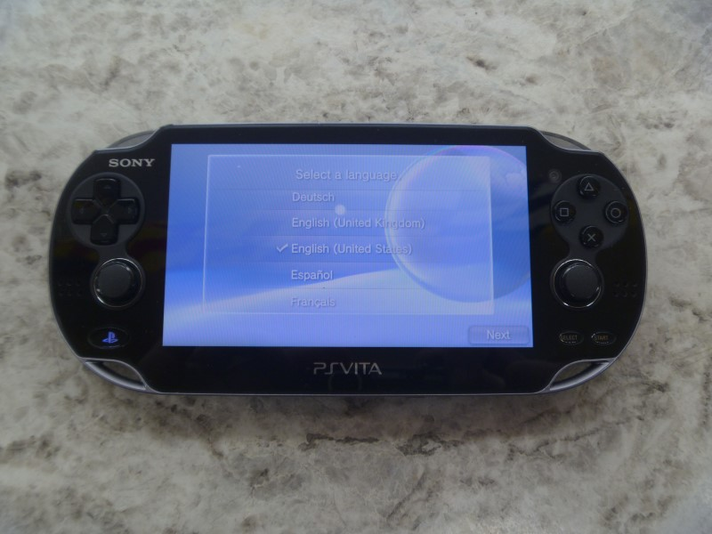 SONY PS VITA PCH-1001 - AFTERMARKET CHARGER - NEAR MINT, ONE SMALL SCRATCH