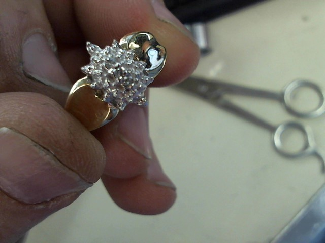 Lady's Diamond Cluster Ring 3 Diamonds .06 Carat T.W. 10K Yellow Gold 3.1g