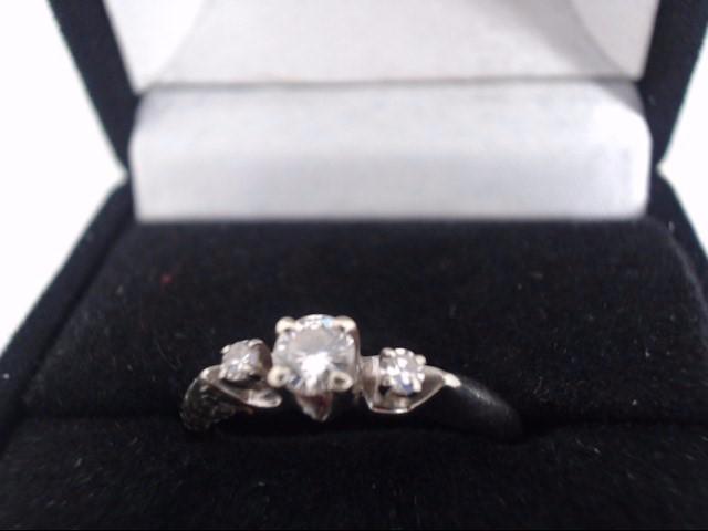 Lady's Diamond Fashion Ring 3 Diamonds .25 Carat T.W. 14K White Gold 2.1g