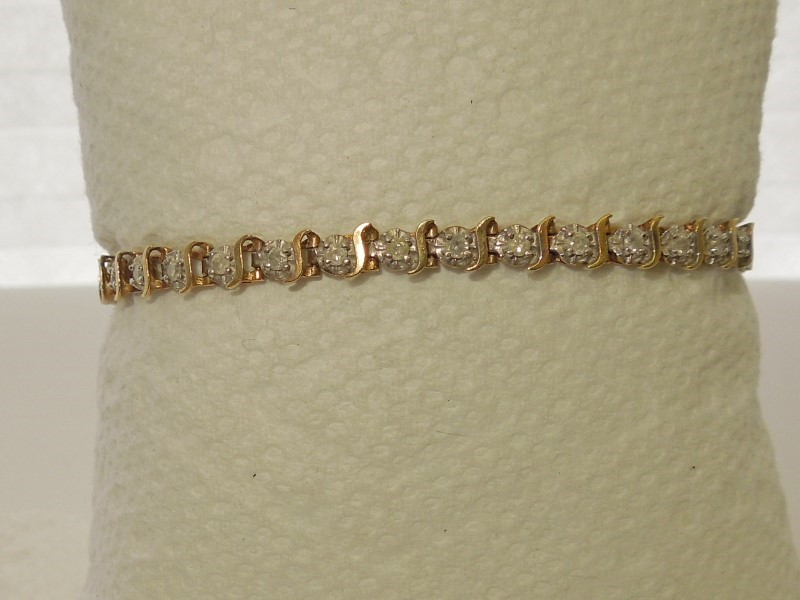 Gold-Diamond Bracelet 35 Diamonds .70 Carat T.W. 10K Yellow Gold 6.9g