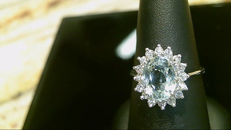 Lady's 14k white gold oval genuine aquamarine and round diamond sz 8 ring