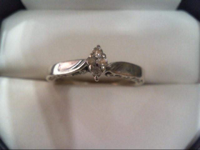 Lady's Silver-Diamond Ring 4 Diamonds .12 Carat T.W. 925 Silver 3.2g
