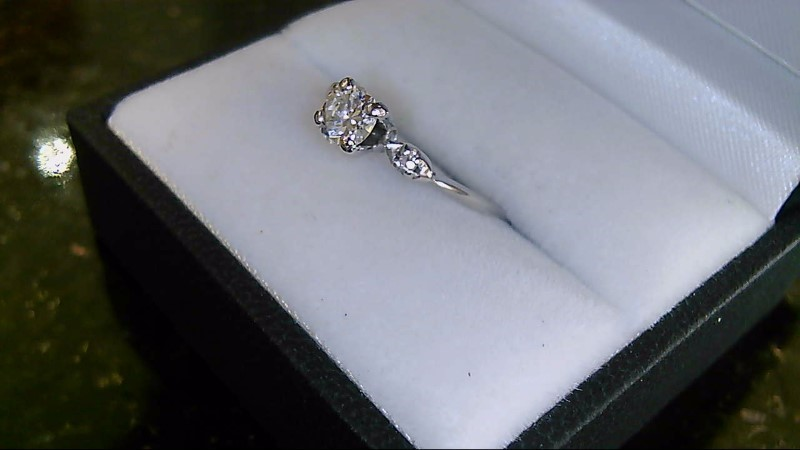 Lady's 14k white gold 1/2ct round diamond and 2 side-1mm rd diamond ring