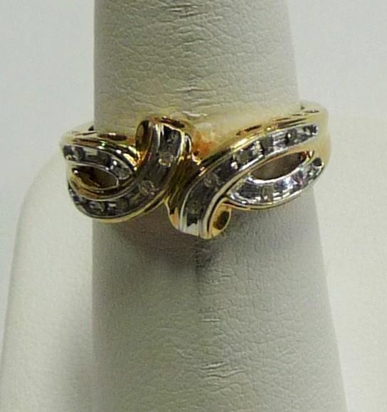 Lady's Diamond Fashion Ring 14 Diamonds .14 Carat T.W. 10K Yellow Gold 1.81dwt