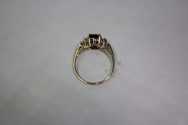 Lady's Purple Stone & Diamond Ring 4 Diamonds .04 Carat T.W. Size: 6.5