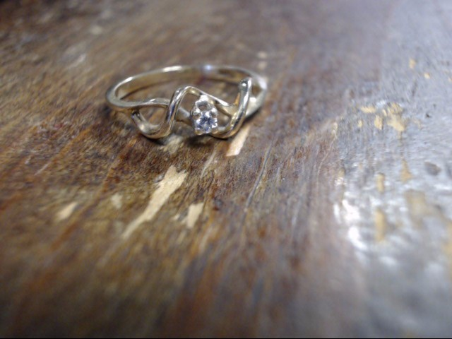 Lady's Diamond Solitaire Ring .05 CT. 14K Yellow Gold 1.1g