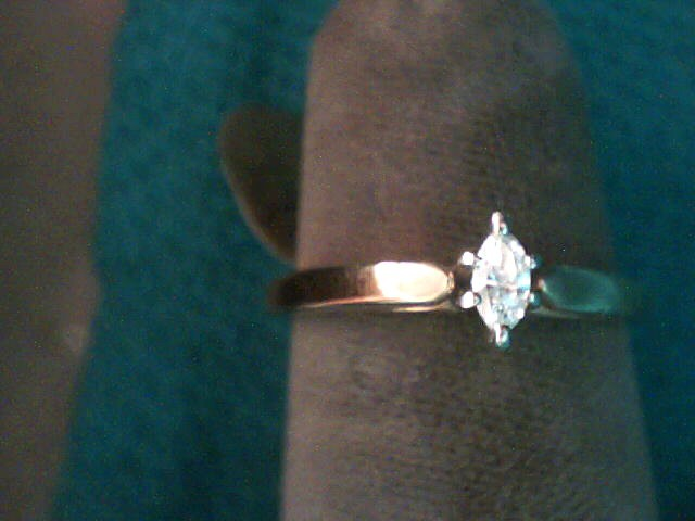 Lady's Diamond Solitaire Ring .09 CT. 10K Yellow Gold 1.5dwt