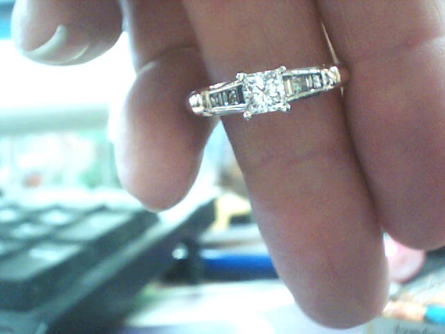Lady's Diamond Solitaire Ring 9 Diamonds .78 Carat T.W. 14K Yellow Gold 3dwt