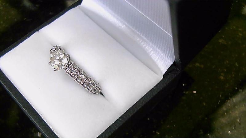 lady's 14k white gold .86ct round diamond with round diamonds ring