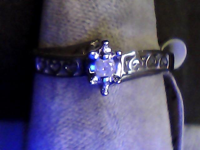 Lady's Diamond Fashion Ring .03 CT. 10K White Gold 1.5dwt