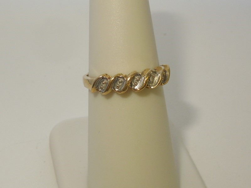 Lady's Diamond Fashion Ring 5 Diamonds .05 Carat T.W. 10K Yellow Gold 2g