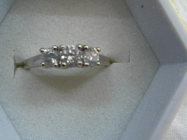 Lady's Diamond Wedding Band 3 Diamonds .39 Carat T.W. 14K White Gold 1.8g