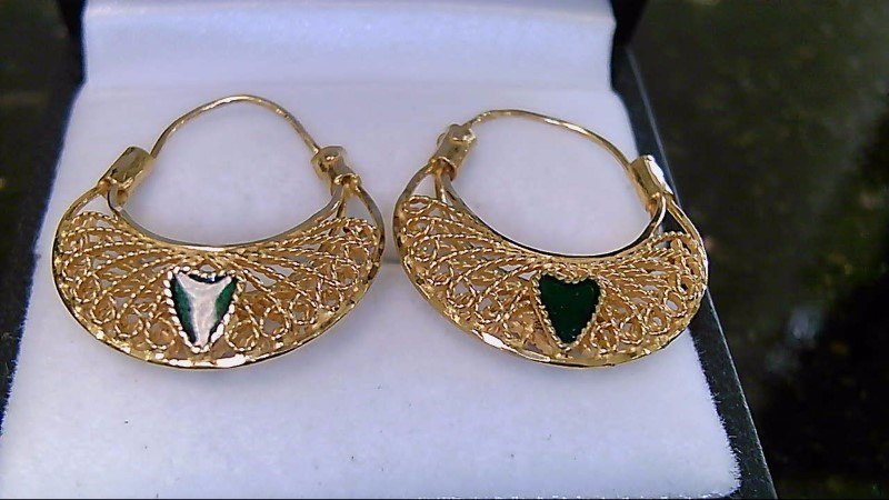 Lady's 21k ruby heart on side of heart and emerald heart on other side of earrin