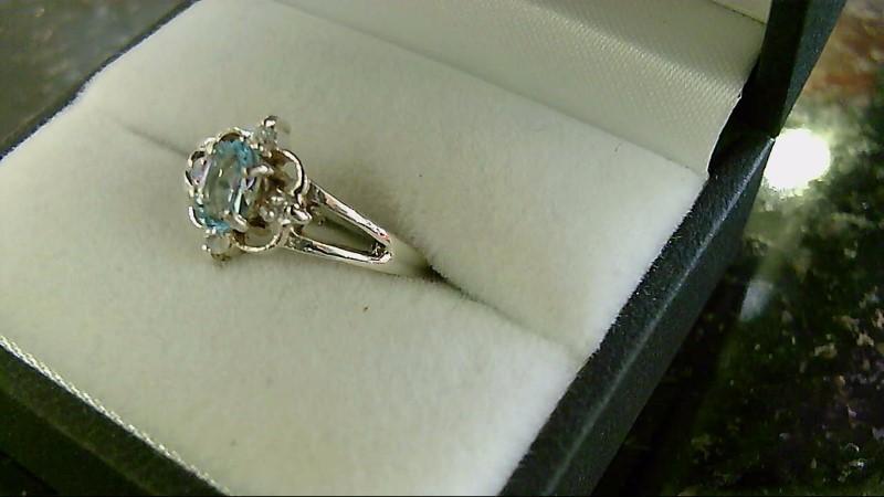 Lady's sterling silver sz 7 oval blue topaz ring