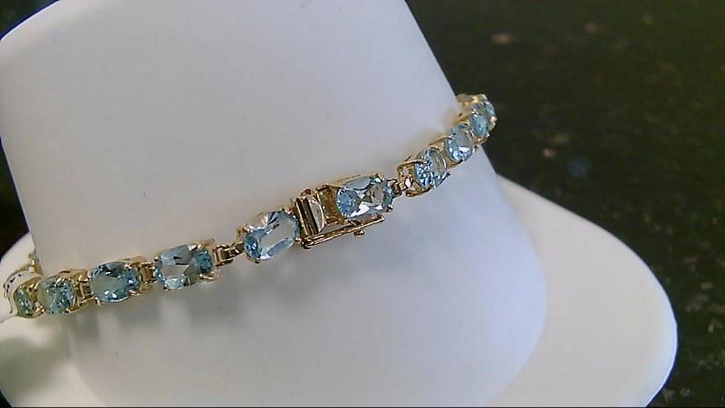 "7"" Synthetic Blue Topaz Gold Bracelet 14K Yellow Gold 7.2g"