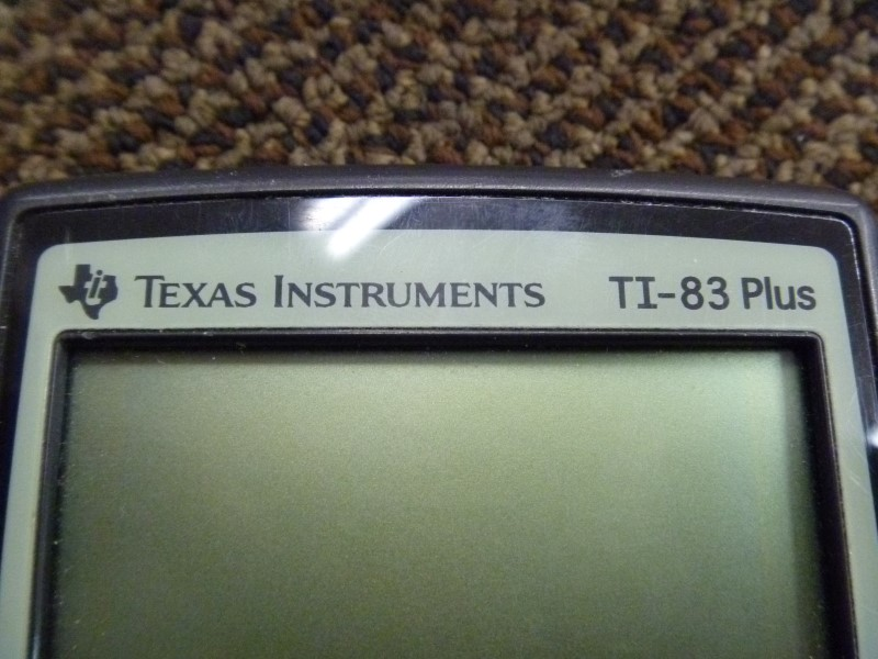 TEXAS INSTRUMENTS TI-83 PLUS GRAPHING CALCULATOR WITH CASE